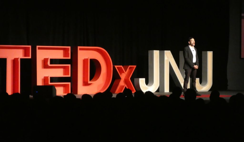 Zach Schleien speaking at TEDx
